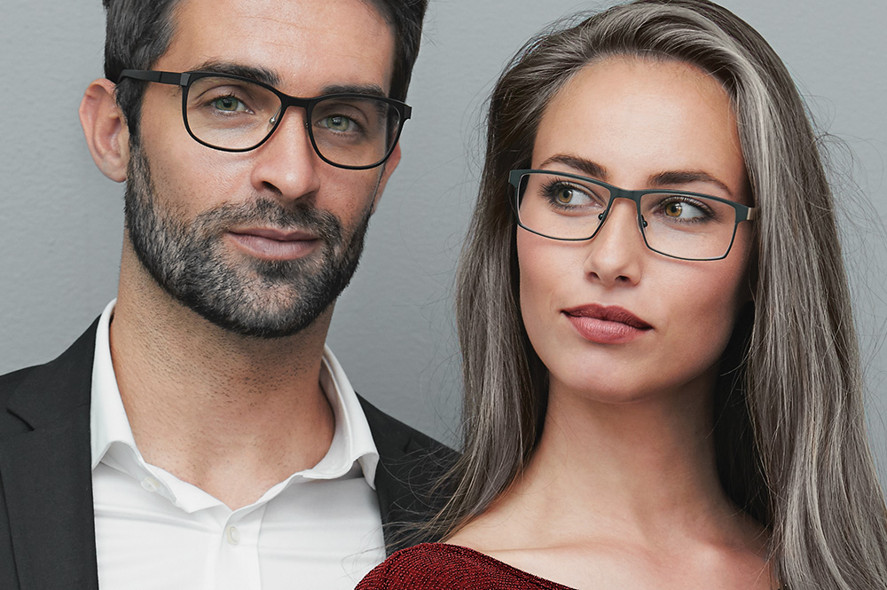 Picture of a woman wearing glasses for the product line of Eagle lenses from FEA Industries.
