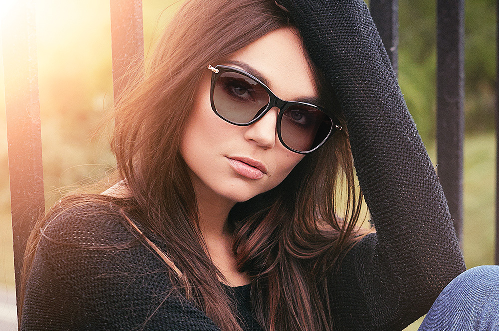 Picture of a woman wearing glasses for the product line of Photochromic lenses from FEA Industries.